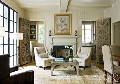 "At one end of the family room, the fireplace is flanked by doorways leading to a pantry and home office. Doors found at Linda Horsley Antiques make a unique style statement and were, in fact, the springboard for the entire space. ""We found the doors before we did another thing in that room,"" says designer Beth Ervin."
