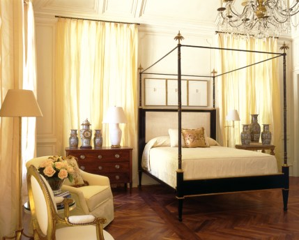92) An elegant tester bed is the focal point of this French-inspired bedroom by Stan Topol.