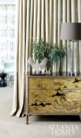 The Diana Credenza by Jean de Merry, also available through R Hughes, adds a touch of glamour to the master bedroom.