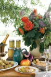 Floral arrangements were composed of dahlias, zinnias, mauve Queen Anne's Lace, nigella pods, Limelight hydrangea, Joe-Pye weed and foliage from fig and sweetgum trees.