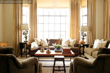 Perfectly neutral and wonderfully comfortable, the family room will stand the test of spills, sun, traffic and time thanks to a custom-designed rug by Eve, Inc., upholstered pieces from Bernhardt and a Lillian August coffee table. Curtain and pillow fabrics, Sabina Fay Braxton.