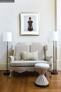 """A quirky upholstered linen settee serves as an eccentric counterpoint to Vee Speers"""" photograph, """"Untitled,"""" from The Birthday Party Series #37."""