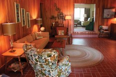 """Wood paneling, a round braided rug and brick flooring are just a few of the period details used in the set decoration for character Elizabeth Leefolt""""s groovy den."""