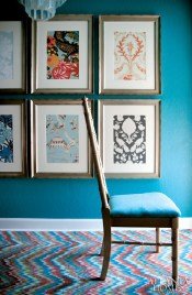 Framed wallpaper swatches are cleverly grouped as eye-catching art in the eclectic dining room.