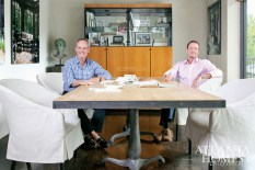Photography by Christina Wedge. A conference table, custom-made by Kevin Scanlon, is one of the few new pieces. Its double cast-iron pedestal drafting bases and bleached-oak top with metal strapping ensure the space is anything but an ordinary conference room. Spitzmiller, left, and Norris.