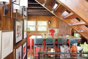 A fiery red hue emanates from the kitchen's lower cabinets.