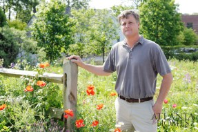 Smith stands in the wildflower meadow behind his studio.Now a 2,500-square-foot space located on an acre-and-a-half property, the studio employs 23.