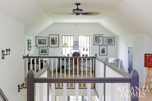 The upstairs office of landscape architect Alex Smith includes framed black-and-white photographs taken by his brother and a collection of arrowheads honoring his father.