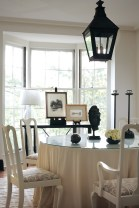 93) By painting the antique chairs in her dining room, Beth Webb gave them a new lease on life, making them chic once again.