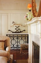 95) A rocking horse serves as a powerful focal point in this living room by Barbara Howard.