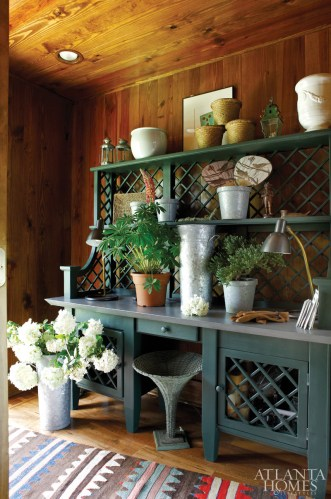 Inside the back entrance to the house is a zinc-topped potting bench from Mecox Gardens—the perfect place to arrange flowers from the pocket garden just outdoors.