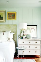 Smoky aqua walls and furnishings in pale hues give the master bedroom an open and airy feeling. On the bedside table is a work on paper by Cocteau.