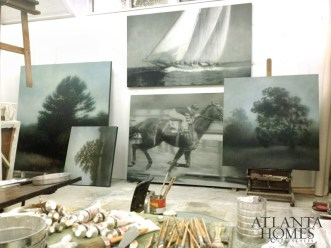 Dines built his at-home studio with the help of a friend; his pastoral landscapes are wildly popular.