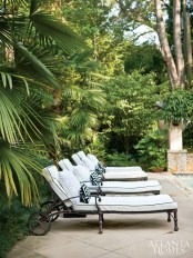 A quartet of comfortable chaise lounges greets guests poolside.