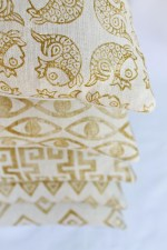 Her line's metallic gold colorway on natural linen makes for both an elegant and playful look.