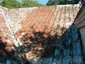 "The home""s original metal roof was replaced with thousands of galvanized steel tiles."
