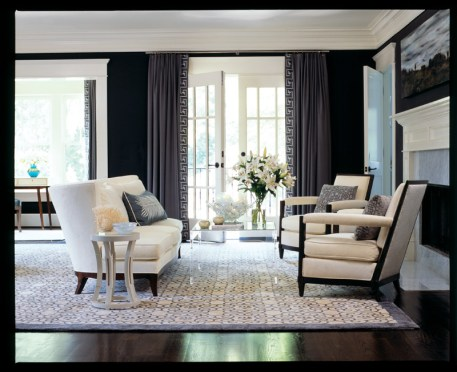 In this adults-only retreat, seating pieces are decked out in warm white linen velvet, pulling up to a Lucite coffee table.