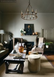 """Jimmy Stanton""""s country and city dwellings are more alike than one might expect for homes with such disparate purposes. Namely, both are outfitted entirely in neutrals""""mostly rich, warm grays and khakis""""shades that Stanton describes as comfortable colors. """"I like all neutrals with pops of color,"""" he explains. """"It""""s modern, but it still has that really relaxed feel."""" Still, each home has its unique grace notes. Where his Madison, Georgia, house leans soft and traditional, his condo at Westside Provisions is much more graphic and modern, with well-placed punches of bright color."""