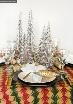 Mix+Match Creating the ultimate tabletop should be about mixing it up with personal treasures. This design by Erika Reade Ltd. incorporates a charming quilt, faux bamboo flatware and a glass forest of towering Christmas trees. For an extra dollop of whimsy, there are ornaments fashioned as napkin rings and place cards tied on to small tree logs.