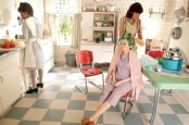 """The Help""""s Production Designer, Mark Ricker, used a turquoise laminate table and blue-and-white checkerboard linoleum floor to create a classic sixties kitchen set. Lead character Skeeter (Emma Stone) is seated at the table as her mother, Charlotte Phelan (Allison Janney), tries to straighten her hair."""