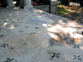 "In complete disrepair, the porch""s classic black-and-white porcelain tile was replicated by a small midwest company for the restoration."