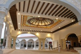 Guests gain a grand first impression as they enter the elegant domed motor lobby leading to an expansive, open-air lobby with ocean views.