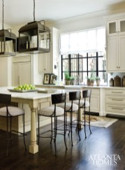 A collaboration between Morris and kitchen designer Cynthia Ziegler, the kitchen boasts a pair of Paul Ferrante lanterns and leggy seating.