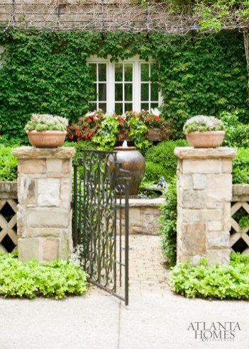 Boston ivy provides a lush backdrop for the private courtyard of this Buckhead garden designed by Alex Smith.