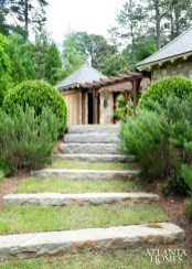 Behind the pool pavilions, granite steps lead down to a vegetable garden.