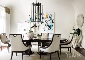 A lively painting by contemporary artist Anthony Liggins and Bradley's Conrad chandelier set the stage for entertaining in the dining room of this Buckhead abode by interior designer Michel Boyd.
