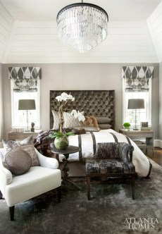 In the texture-driven master bedroom, Boyd softened the space's soaring ceiling with a jewel-like Restoration Hardware chandelier and a commanding, oversize tufted headboard.