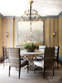 A Schumacher wallcovering in the dining room, lends an intimate feeling thanks to its dark, earthy tones.