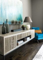 Cabinet, Bolier & Co. Artwork, Melissa Key. Chair, Ligne Roset. Lamp, Arteriors.