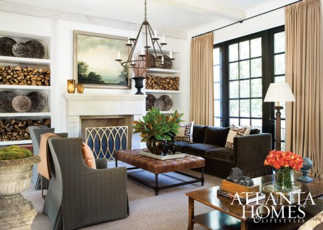 The great room, directly off the front entry, provides an introduction to home's elegant but livable aesthetic. Chandelier, Jerry Pair. Tufted leather ottoman, Holland & Company. Verellen sofa, Bungalow Classic.