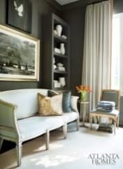 The wife's office, separated from the great room by sliding doors, is a powerful juxtaposition of warm and cool tones. Pale blue settee by Mr. Brown.