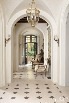 Meant to appear as though it developed progressively throughout the Middle Ages, early Renaissance and French Rococo periods, this Atlanta home is furnished with design objects culled from France, which was also the far-flung source of its beautiful antique marble floors.