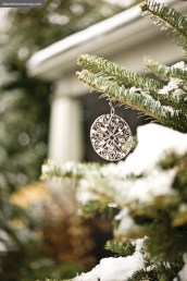 A collection of simple but intricate vintage silver discs are among Erica's favorite things to hang on their tree.