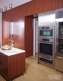 """""""We encouraged the combination of stained wood, white marble and stainless steel. All of these are classic materials, but used in a modern way."""" –D. Stanley Dixon"""