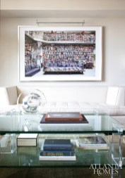 In the living room of a high-rise residence in Midtown, designer Bill Musso placed a photograph by Todd Selby, represented by Jackson Fine Art, above a sofa by Armani Casa. The coffee table is from Smith Grubbs & Associates.