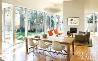 Interior design decisions were made with the help of Katherine Hojnacki, but Loudermilk added her own decoration, such as a single sweet Americana chair often pulled up to the dining table. Knoll Rissom chairs, a George Nelson Saucer pendant and Eames molded-plastic Eiffel chairs serve as modern grace notes. Carpenter engineered the house to have a south-facing passive solar side and overhanging eaves to shade the home from summer heat. In the winter, the sun's warmth is captured in the energy-efficient home.