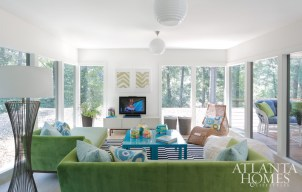 Color and pattern define the children's tree house-like playroom. The sofas are upholstered in two tones of Perennials outdoor fabric with Alan Campbell and Jim Thompson's No. 9 Thompson patterned pillows. Acrylic Ikea tables combine to make one large coffee table and play surface.