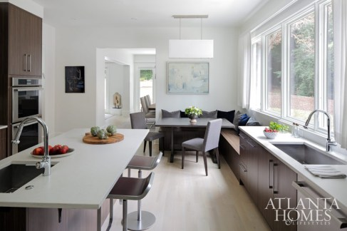 The kitchen was designed by Mary Kathryn Timoney of Design Galleria Kitchen and Bath Studio. Breakfast table by Skylar Morgan Furniture + Design. Art from Anne Irwin Fine Art.