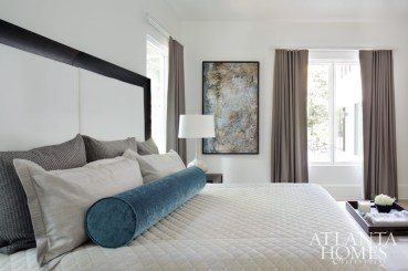 In the master bedroom, Witzel custom-designed bed linens using fabric from Romo and Nobilis. Art from Bill Lowe Gallery.