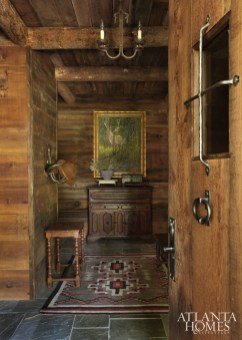 The Navajo-style rug from the Peace Design Collection and a Paul Kay painting set the tone in the entryway for this distinctly Western cabin.