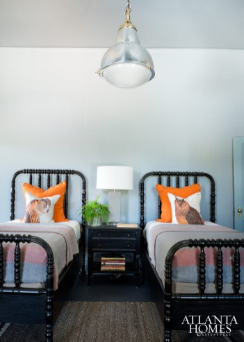 The owl toss pillows on the twin beds are Thomas Paul.