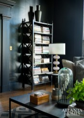 A leggy shelf in a casual living area stows Stanton's favorite tomes; the Christopher Spitzmiller lamp was a splurge.
