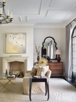 Interior designer Melanie Millner applied her tailored and inviting aesthetic to the formal living room, where steel-and-glass doors allow ample daylight.