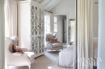 """""""We wanted a proper master bedroom and bath, which this house didn't really have when we purchased it,"""" says Courtney, who also applauds Litchfield's approach for the stylish but efficient laundry room. The master bedroom was explicitly designed to accommodate the couple's canopy bed and Thomas O'Brien side chests. It reads as ultra-feminine and inviting, thanks to the plush wool rug, antique French bergères and reflective surfaces."""