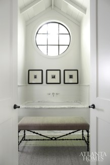 The master bath contains one of architect William B. Litchfield's signature windows, as well as a trio of framed Masao Yamamoto photographs (through Jackson Fine Art).