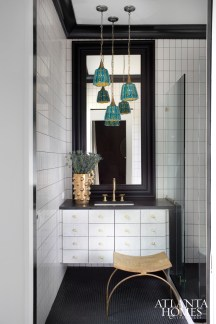 After scoring an amazing set of vintage turquoise pendants for Madison's bathroom, Lee was inspired to carry this color throughout the main level of the